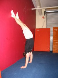 Handstand facing away from the wall, improper position